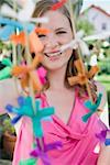 Woman with coloured garlands for a garden party Stock Photo - Premium Royalty-Free, Artist: Kevin Dodge, Code: 659-02212010