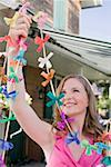 Woman with coloured garlands for garden party Stock Photo - Premium Royalty-Free, Artist: Kevin Dodge, Code: 659-02212011