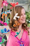Woman with coloured garlands for garden party Stock Photo - Premium Royalty-Free, Artist: Kevin Dodge, Code: 659-02212012
