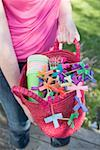 Woman holding basket of decorations for a garden party Stock Photo - Premium Royalty-Free, Artist: Kevin Dodge, Code: 659-02212014