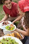 Young couple at a barbecue Stock Photo - Premium Royalty-Free, Artist: Kevin Dodge, Code: 659-02212068