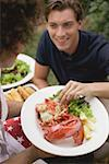 Man taking a piece of lobster from a plate Stock Photo - Premium Royalty-Free, Artist: Kevin Dodge, Code: 659-02212069