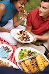 Couple with grilled spare ribs, corn on the cob, salad, on grass Stock Photo - Premium Royalty-Free, Artist: Kevin Dodge, Code: 659-02212104