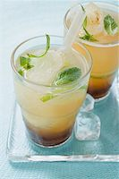 Two Tequila Sunrises Stock Photo - Premium Royalty-Freenull, Code: 659-02213499