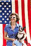 Patriotic woman and Boston Terrier dog posing with American flag Stock Photo - Premium Royalty-Free, Artist: Yvonne Duivenvoorden, Code: 673-02216549