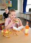 Boy Eating Fast Food Lunch    Stock Photo - Premium Rights-Managed, Artist: Anders Hald, Code: 700-02217419