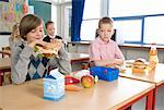 Boy with Fast Food Lunch Looking at Boy with Healthy Lunch    Stock Photo - Premium Rights-Managed, Artist: Anders Hald, Code: 700-02217421