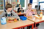 Boy with Healthy Lunch Looking at Boy with Fast Food Lunch    Stock Photo - Premium Rights-Managed, Artist: Anders Hald, Code: 700-02217422