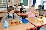 Children Eating Lunch in Classroom    Stock Photo - Premium Rights-Managed, Artist: Anders Hald, Code: 700-02217427