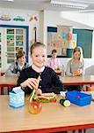 Students Eating Lunch in Classroom    Stock Photo - Premium Rights-Managed, Artist: Anders Hald, Code: 700-02217460