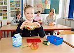 Students Eating Lunch in Classroom    Stock Photo - Premium Rights-Managed, Artist: Anders Hald, Code: 700-02217461