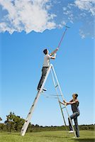 Couple painting the sky blue Stock Photo - Premium Royalty-Freenull, Code: 635-02218841