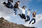 Teenage friends jumping off rock wall Stock Photo - Premium Royalty-Freenull, Code: 635-02219004