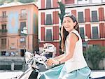 Woman riding scooter Stock Photo - Premium Royalty-Free, Artist: Damir Frkovic, Code: 635-02219149