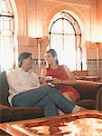 Couple sitting in exotic hotel lobby Stock Photo - Premium Royalty-Free, Artist: Cultura RM, Code: 635-02219160
