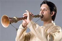 Close-up of a young man playing a clarinet Stock Photo - Premium Royalty-Freenull, Code: 630-02219977