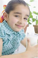preteen  smile  one  alone - Portrait of a girl holding a glass of milk Stock Photo - Premium Royalty-Freenull, Code: 630-02220649