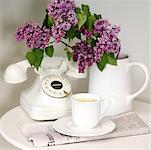 Lemon Tea, Vase of Lilacs, Telephone, and Newspaper on Table Stock Photo - Premium Rights-Managed, Artist: Natasha Nicholson, Code: 700-02235695