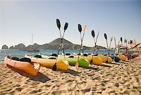 paradise (place of bliss) - Canoes on luxury beach resort Stock Photo - Premium Royalty-Freenull, Code: 614-02241060