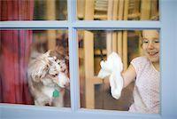 Girl cleaning window Stock Photo - Premium Royalty-Freenull, Code: 614-02241492