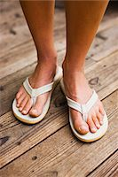 Close-up of Woman Wearing Sandals Stock Photo - Premium Royalty-Free, Artist: Ty Milford, Code: 600-02245354