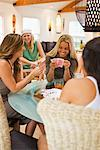Group of Women in a Bungalow Near the Beach, Playing Cards, Encinitas, San Diego County, California, USA    Stock Photo - Premium Rights-Managed, Artist: Ty Milford, Code: 700-02245457
