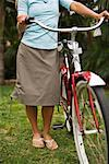 Woman Standing With Cruiser Bike, Encinitas, San Diego County, California, USA    Stock Photo - Premium Rights-Managed, Artist: Ty Milford, Code: 700-02245467