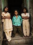Portrait of Children in Doorway, Varanasi, Uttar Pradesh, India