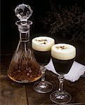 Close-up of glasses of coffee liqueur with a decanter of whiskey    Stock Photo - Premium Rights-Managed, Artist: IIC, Code: 832-02252626
