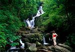 Torc Waterfall, Killarney National Park, County Kerry, Ireland; Woman looking at waterfall    Stock Photo - Premium Rights-Managed, Artist: IIC, Code: 832-02255327