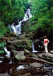 Torc Waterfall, Killarney National Park, County Kerry, Ireland; Woman looking at waterfall    Stock Photo - Premium Rights-Managed, Artist: IIC, Code: 832-02255328