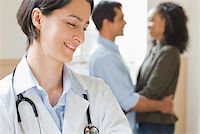 Doctor with embracing couple Stock Photo - Premium Royalty-Freenull, Code: 604-02257464