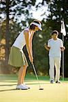 Couple Playing Golf, Salem, Oregon, USA    Stock Photo - Premium Rights-Managed, Artist: Ty Milford, Code: 700-02257739