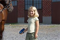 preteen  smile  one  alone - Little Girl Brushing Horse    Stock Photo - Premium Rights-Managednull, Code: 700-02257783