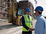 Engineers shaking hands Stock Photo - Premium Royalty-Free, Artist: Westend61, Code: 614-02259673