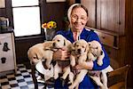 Portrait of Amish Woman Holding Puppies    Stock Photo - Premium Rights-Managed, Artist: George Remington, Code: 700-02260102