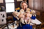 Portrait of Amish Woman Holding Puppies    Stock Photo - Premium Rights-Managed, Artist: George Remington, Code: 700-02260103