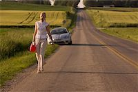 stalled car - Woman Walking Along Country Road, Carrying Gas Can Stock Photo - Premium Rights-Managednull, Code: 700-02260106