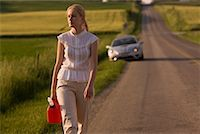 stalled car - Woman Walking Along Country Road, Carrying Gas Can    Stock Photo - Premium Rights-Managednull, Code: 700-02260107
