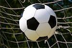 A soccer ball going into the net Stock Photo - Premium Royalty-Free, Artist: photo division, Code: 653-02260381