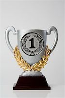 First place trophy Stock Photo - Premium Royalty-Freenull, Code: 653-02260384