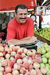 A man working on a fruit stall Stock Photo - Premium Royalty-Free, Artist: R. Ian Lloyd, Code: 653-02260638