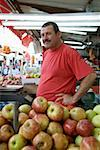 A man working on a fruit stall Stock Photo - Premium Royalty-Free, Artist: AWL Images, Code: 653-02260685
