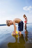 A young boy looking mischievous Stock Photo - Premium Royalty-Freenull, Code: 653-02261044