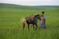 Horseman Walking with Horse, Inner Mongolia, China    Stock Photo - Premium Rights-Managednull, Code: 700-02263889