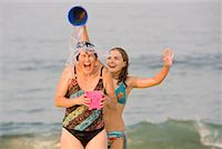 Daughter Pouring Pail of Water on Mother's Head at the Beach, New Jersey, USA    Stock Photo - Premium Rights-Managednull, Code: 700-02263990