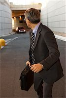 running away scared - Businessman Running from Car    Stock Photo - Premium Rights-Managednull, Code: 700-02264870