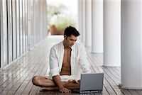 Man Sitting Outdoors, Using Laptop Computer    Stock Photo - Premium Rights-Managednull, Code: 700-02264901