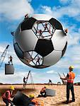 Construction Workers Building a Soccer ball    Stock Photo - Premium Rights-Managed, Artist: Marc Simon, Code: 700-02264969