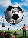 Construction Workers Building a Soccer Ball    Stock Photo - Premium Rights-Managed, Artist: Marc Simon, Code: 700-02264970